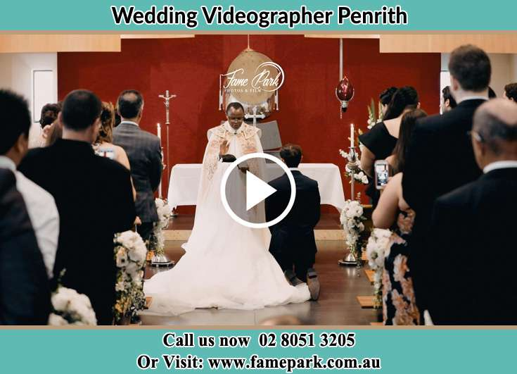 Bride And Groom Kneeling At The Altar In front Of A Pastor Penrith